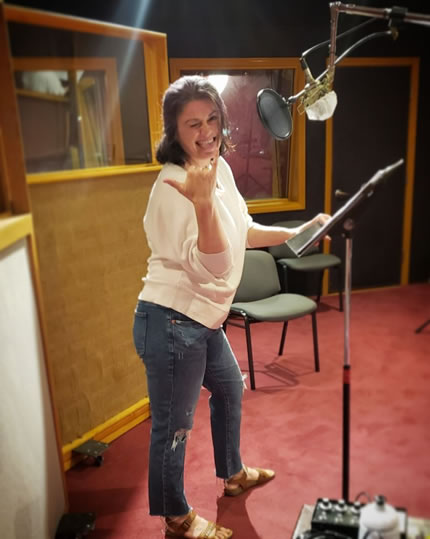 Voice Actor Amy Ulrich in the studio